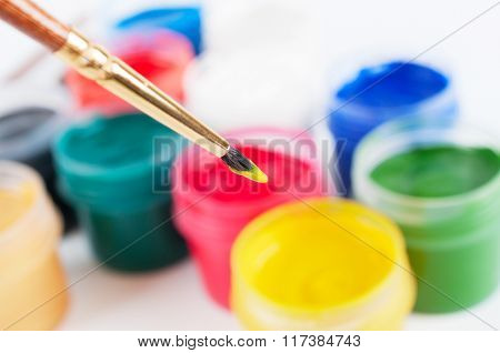Brush And Many Paint Jars With Gouache