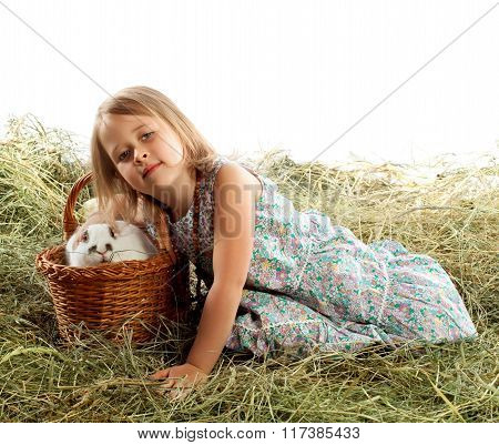 The child plays with the rabbit