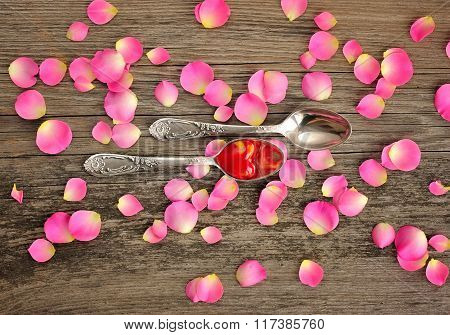 Two Spoons With Red Heart On Wooden Background
