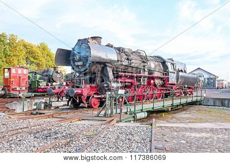 Antique steam locomotive in depot