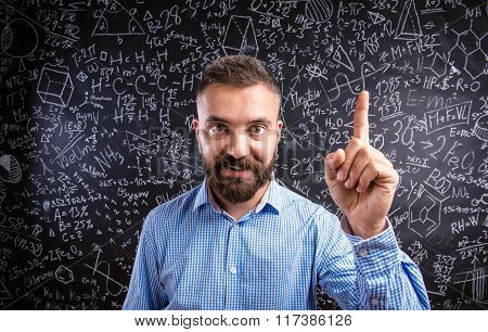 Scolding teacher against big blackboard with mathematical symbol