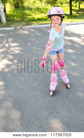 Cute Smiling Little Girl In Pink Roller Skates
