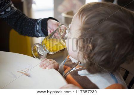 A Little Boy Tries Buckthorn Tea.