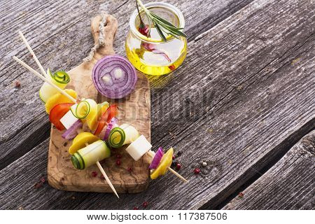 Light summer appetizer with vegetables and cheese on skewers