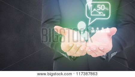 Businessman holding his hands out against grey room
