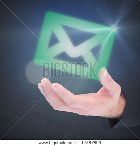Businessman holding hand out in presentation against black room