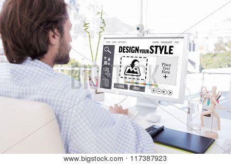 Desinger working on his computer against designer interface