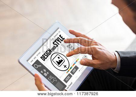 Designer interface against businessman using tablet