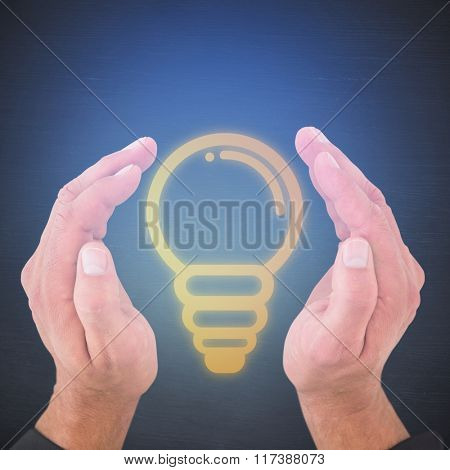Businessman standing with hands out against dark room
