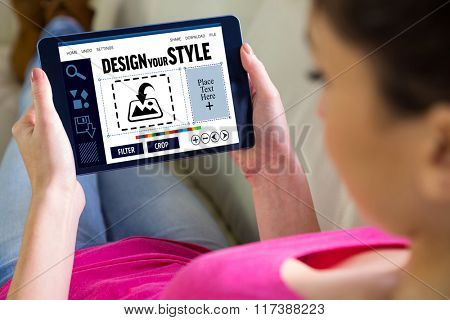 Woman using tablet at home against designer interface