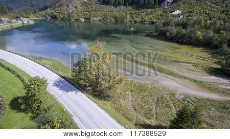 Aerial View From A Lake And Island In Austria, Mountains In The Summer