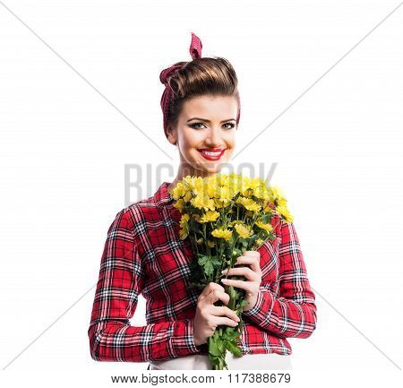 Woman with pin-up make-up and hairstyle holding yellow daisies