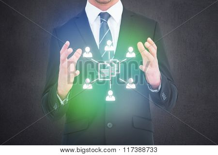 Businessman gesturing with his hands against grey room