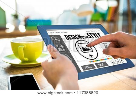 Designer interface against cropped image of hipster businessman using tablet