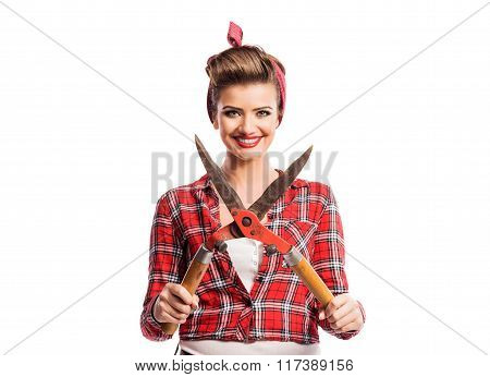 Woman with pin-up make-up and hairstyle holding pruning shears