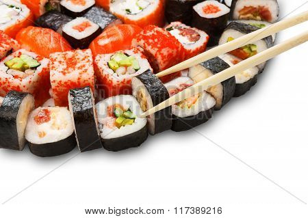 Set Of Sushi, Maki And Rolls Isolated Closeup With Chopsticks