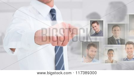 Businessman in shirt presenting at camera against light grey