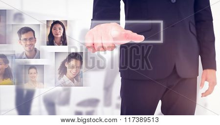 Businessman pointing with finger against white background with vignette
