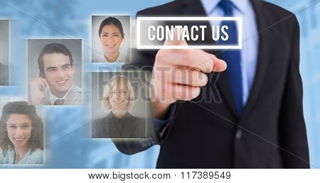 Businessman pointing his finger at camera against blue background