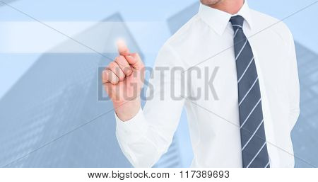 Businessman pointing with his finger against skyscraper