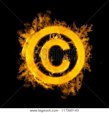 Copywrite logo in fire against black