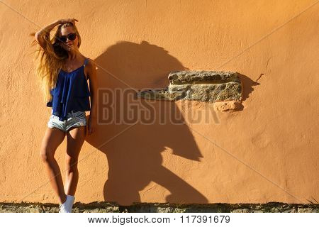 Fashion young woman with long legs in summer clothes