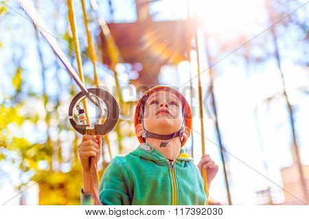 boy in the rope park looking up