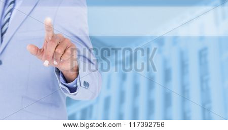Businessman touching invisible screen against blue background