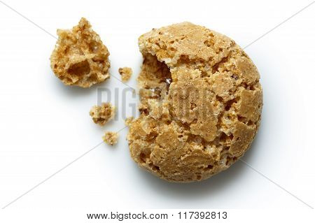 Detail Of One Broken Italian Amaretti Biscuit Isolated On White From Above, With Crumbs.