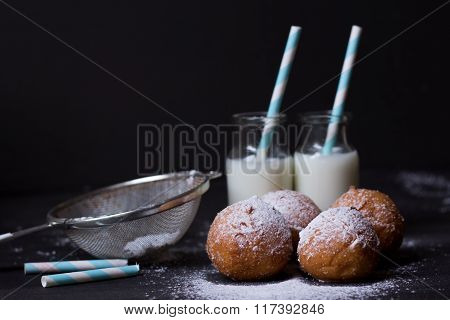 Jelly doughnuts and two bottles of milk