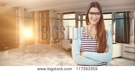 Young creative worker smiling at camera against modern room overlooking city