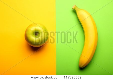 Fresh Apple And Banana On Colorful Background