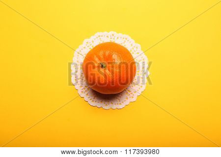 One Tangerine On Yellow Background, Close Up