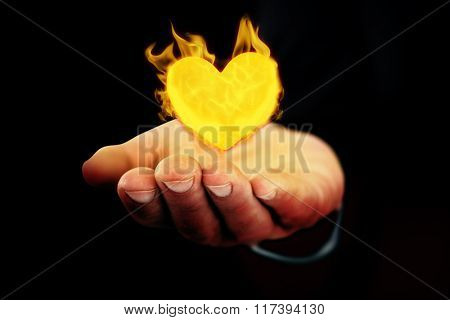 Mid section of a businessman with hands out against black
