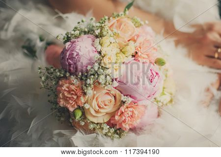 Wedding Bouquet Closeup At The Bridal Dress