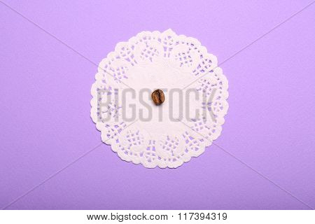One Coffee Bean With Napkin On Purple Background