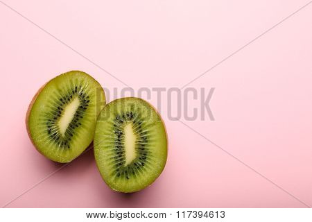 Sliced Kiwi On Pink Background, Close Up