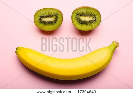 Kiwi And Banana On Pink Backgroud