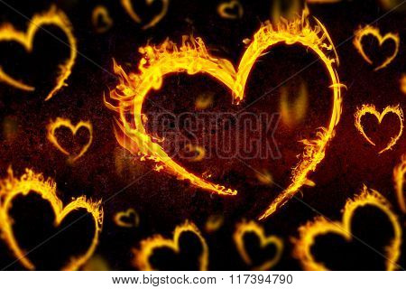 Several heart in fire against dark background