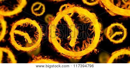 Several clocks in fire against black