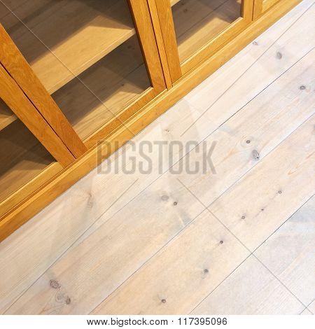 Empty Bookcase On Wooden Floor