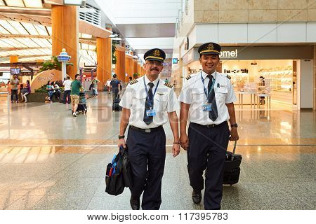 SINGAPORE - NOVEMBER 07, 2015: pilots at Changi Airport. Singapore Changi Airport, is the primary civilian airport for Singapore, and one of the largest transportation hubs in Southeast Asia