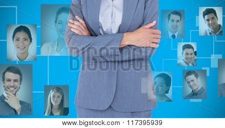 Portrait of smiling businesswoman standing arms crossed against blue background with vignette