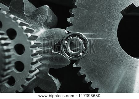 titanium and steel gears against black background