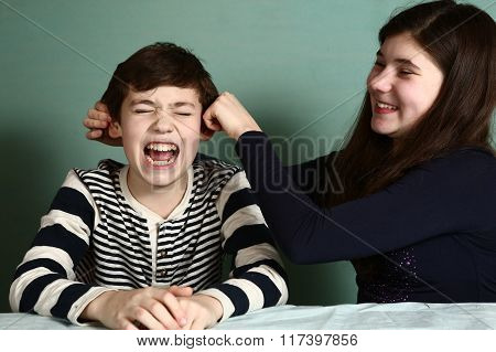 Sister Pull Her Brother Boy Ears Because Of Bet