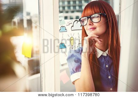 Attractive smiling hipster woman thinking against adhesive notes on window