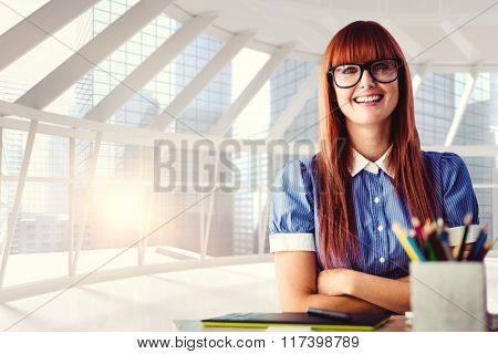 Attractive hipster woman with crossed arms against modern room overlooking city