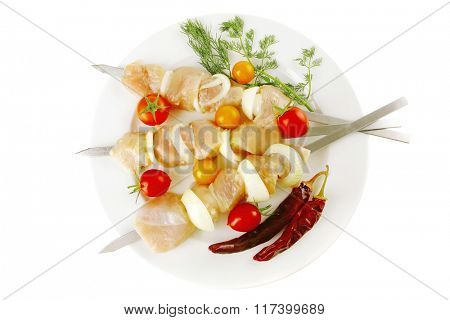 raw fresh chicken shish kebab on white plate