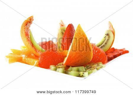 fresh served fruits salad on white dish