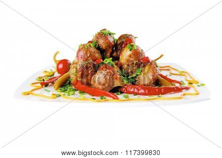 roast meat balls on white dish with peppers